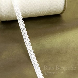 "1/2"" Wide Ivory and Black Rigid Circle Lace Trim"